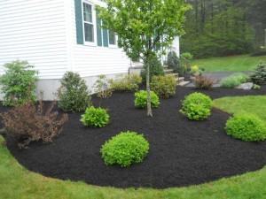 Best price in omaha mulch omaha for Dark brown landscape rock